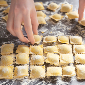 Woman holding uncooked ravioli